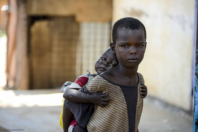 Abandoned by their parents, this little boy and his sister have resorted to begging for money and food in Aweil, South Sudan.