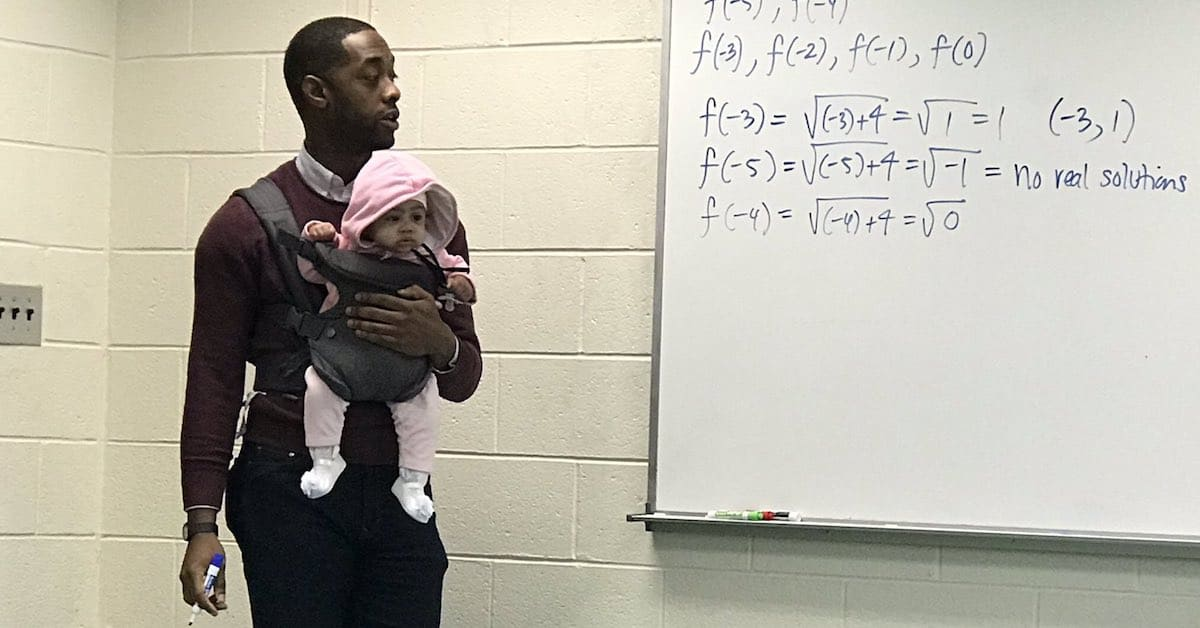 An Amazing Math Professor Teaches While Holding His Student's Baby, As She Couldn't Find A Babysitter