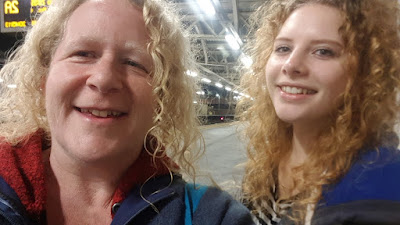 my daughter and I at a train station both smiling to camera