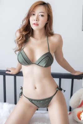 Hot and sexy photos of beautiful busty asian hottie chick Thai babe model Dolly Yui photo highlights on Pinays Finest Sexy Photo Collection site.