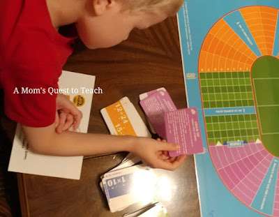 examining the cards of Math Sprint and the board game