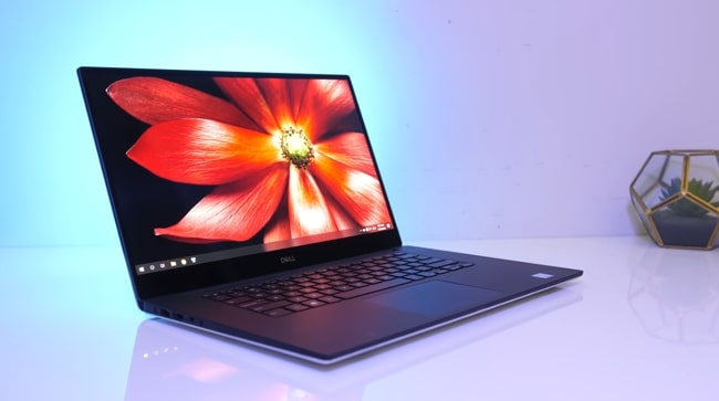 Dell XPS 7590 15.6 inch laptop. It's the only laptop coming with Intel Core i9 processor and dedicated NVIDIA 4GB GDDR5 GPU with long-lasting 97WH battery. So, a business class laptop to meet the gaming needs with small-scale machine learning programming.