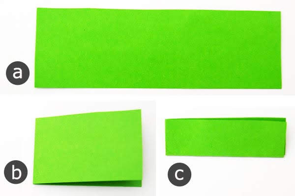 "Langkah Gunting persegi panjang 1 ""x 3"" dari kertas hijau"
