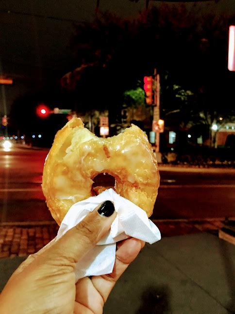 Half eaten Donut from Urban Donut shop in Dallas Texas. The Joyful List