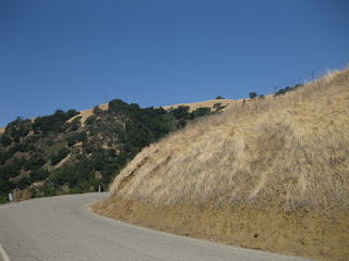 Curve rounding a dry hill on Calaveras Road, above Milpitas, California