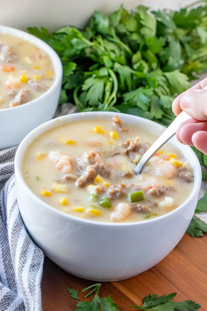 Chowder with hand and spoon