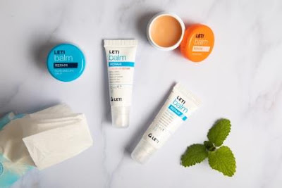 Letibalm products on flat-lay board with tissues
