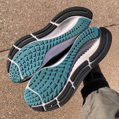 Waffle outsole of both Nike Pegasus 38 pairs