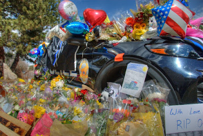 Sign and Flowers on Police Car