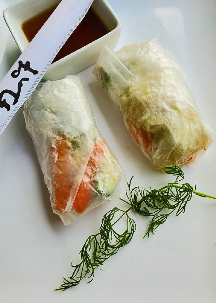 these are an Asian wrapper made with rice paper and filled with meats and vegetables called spring rolls