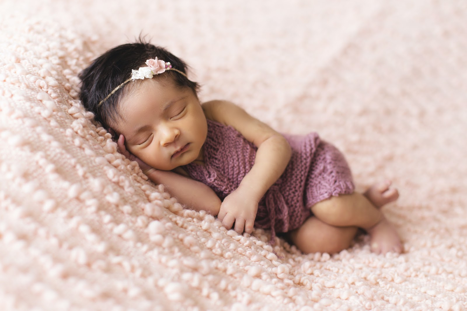 toddler-lying-on-pink-fleece-pad-baby-images