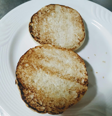 Toasted two halves of burger bun for veg burger recipe