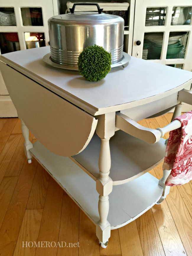 cart with tea towel and cake plate