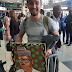 Oyinbo Man Spotted With Buhari's Picture At Lagos Airport. See What He Said