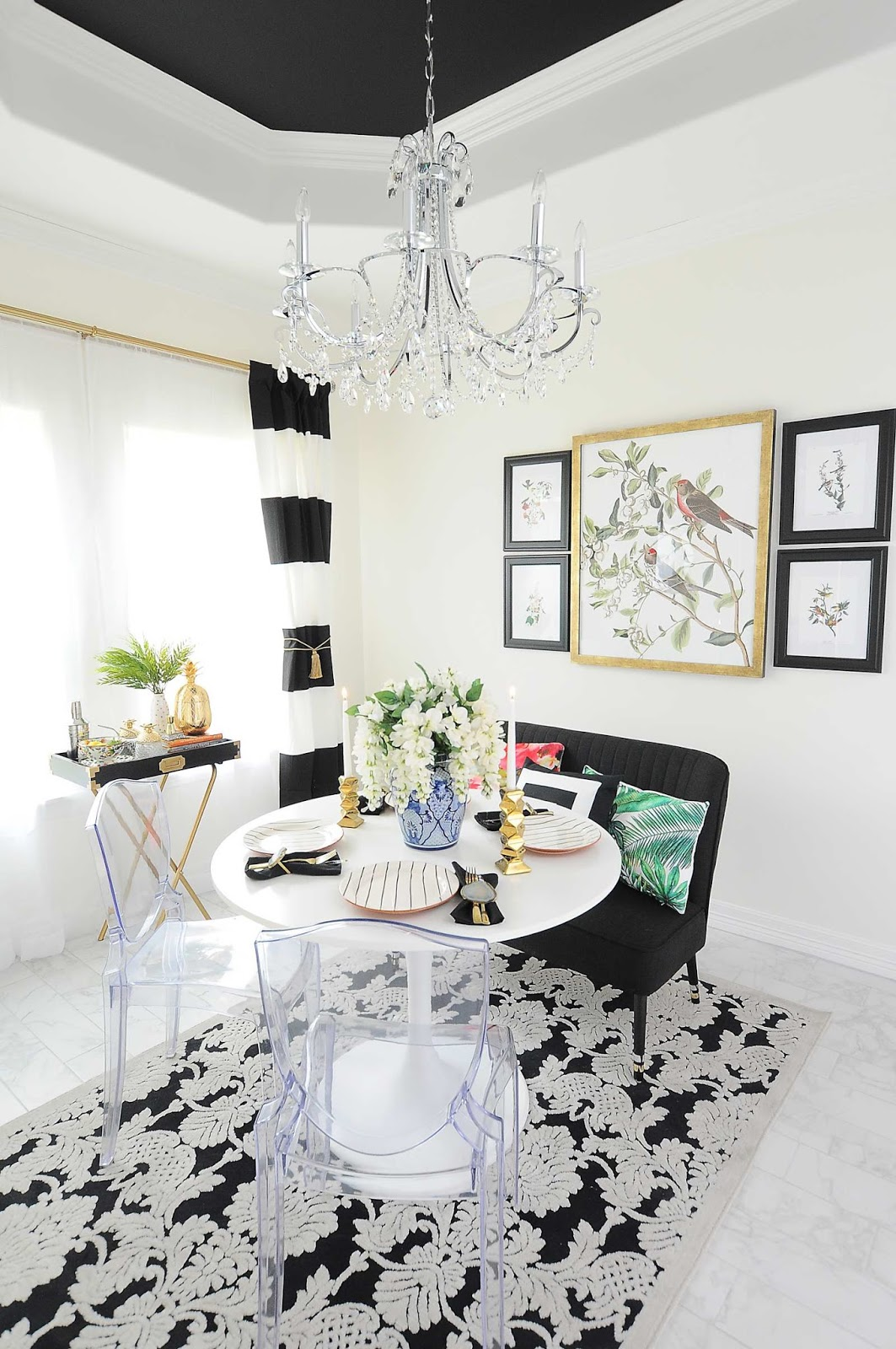 A small dining space gets a makeover using black and white striped curtains, audubon printables, chinoiserie accents and lots of florals and botanicals.