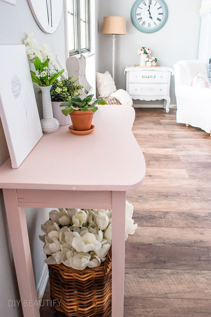 curvy pink vintage table with plants
