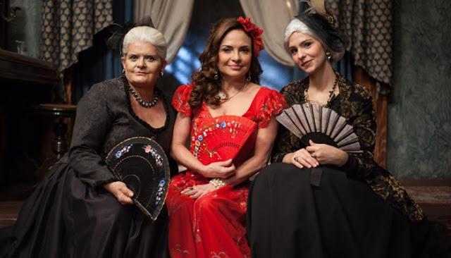 Madame Uraca, baronesa (Jussara Freire) Figurino escrava mãe, vestido preto com Rosalinda de vermelho