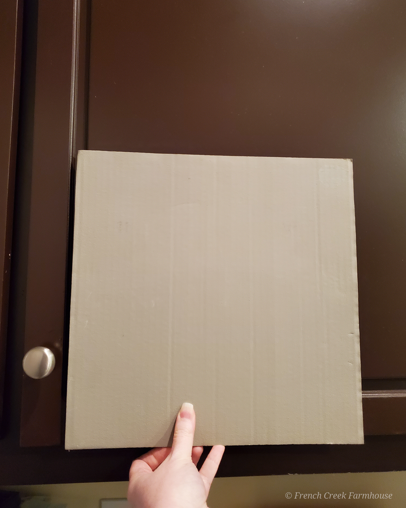 Paint a large swatch of paint on cardboard that can be moved around the room