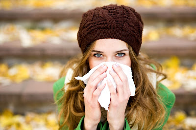 Woman suffering from a cold.