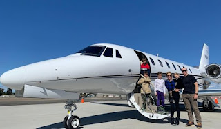 Baylen Robert Brees clicking picture with his family in front of private jet