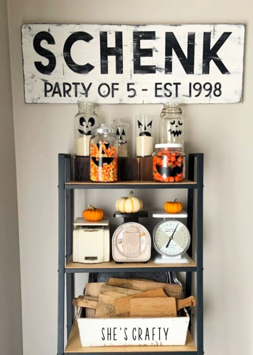 Halloween Home Tour - pumpkin treat jars on farmhouse shelving unit  |  She's Crafty