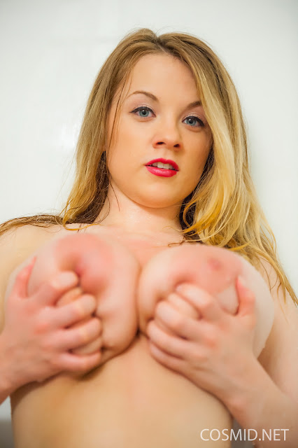 Emily Born squeezing her boobs hard