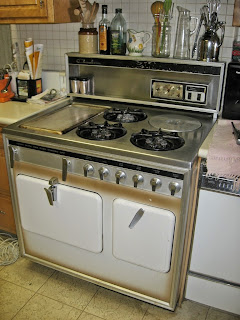 Photo of vintage Model D Chambers stove with green-white coloring in kitchen, also known as MR-9H