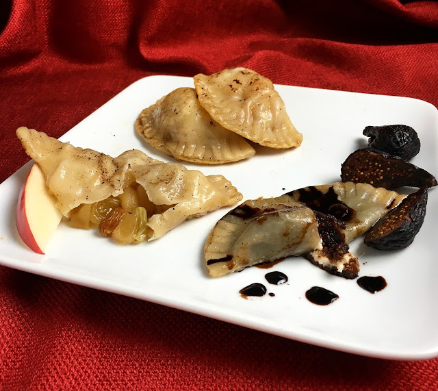 Plate of Bourbon Apple Raisin and Balsamic Fig & Goat Cheese Pierogi
