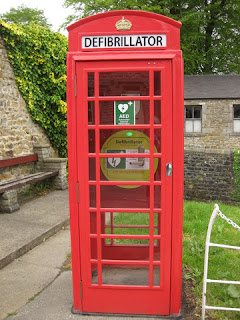 Defibrillator in a repurposed red phone booth, Waddington, Lancashire, England