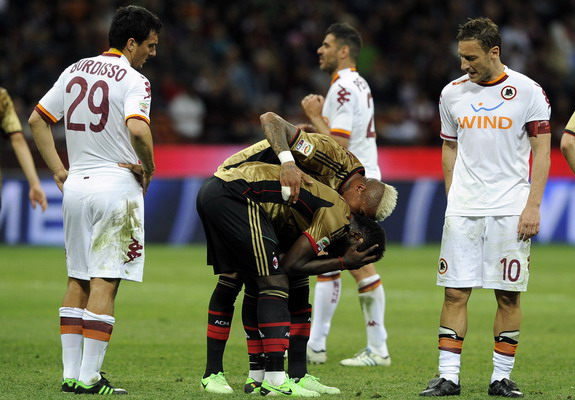 AC Milan player Sulley Muntari reacts after being shown the red card against AS Roma
