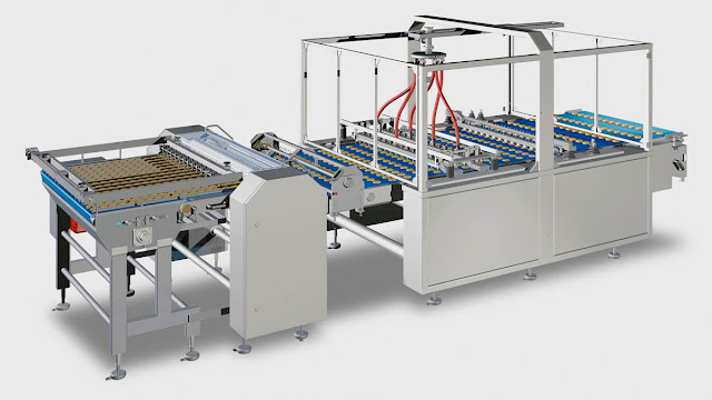 Biscuit sandwiching machines