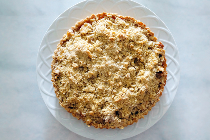 baked brown sugar apple crumble tart on a plate
