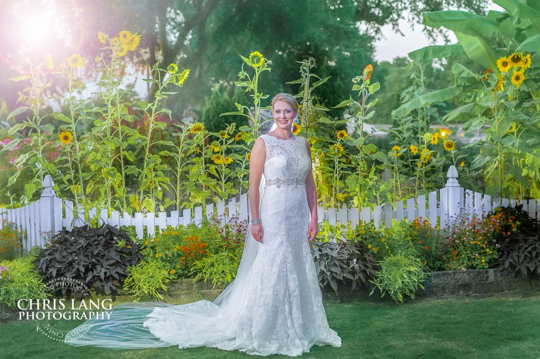 Bridal Picture in the Garden of the Arboretum in Wilmington NC - Alice in Wonderland bridal concept and ideas