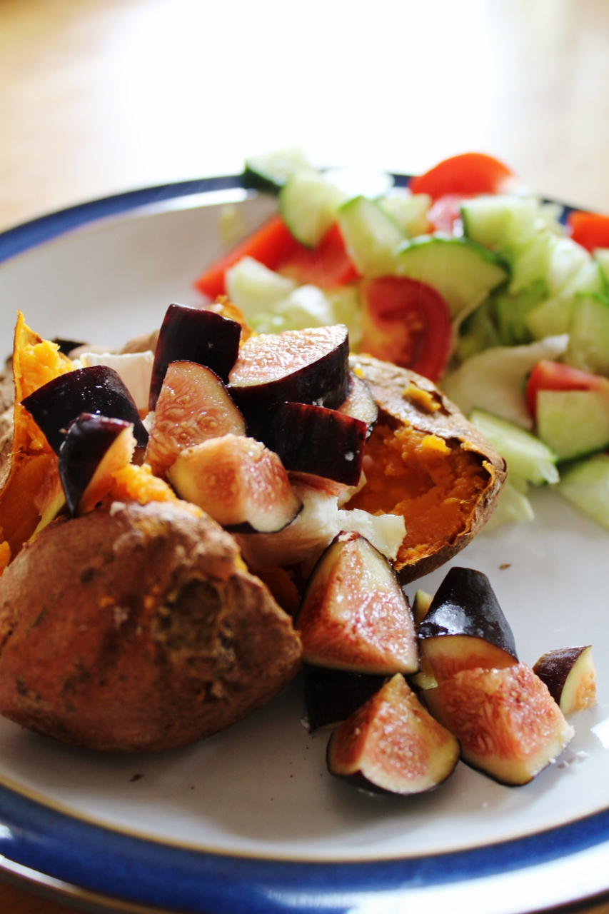 Baked sweet potato served with chopped fig and goats cheese