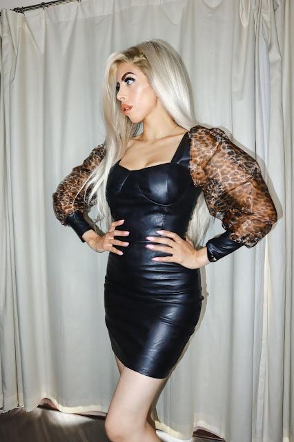The Femme Luxe Black Faux Leather Leopard Print Organza Sleeve Mini Dress in model Baldwin.