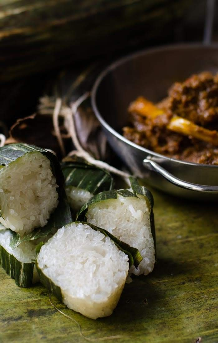 Glutinous rice cooked in banana leaves