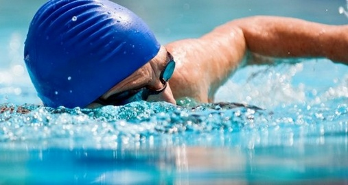 Why when swimming legs often experience cramps