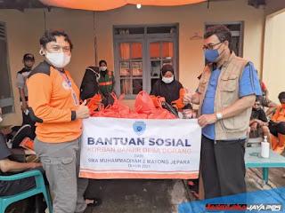 SMA Muhammadiyah 2 Mayong Salurkan Bantuan Banjir Desa Dorang