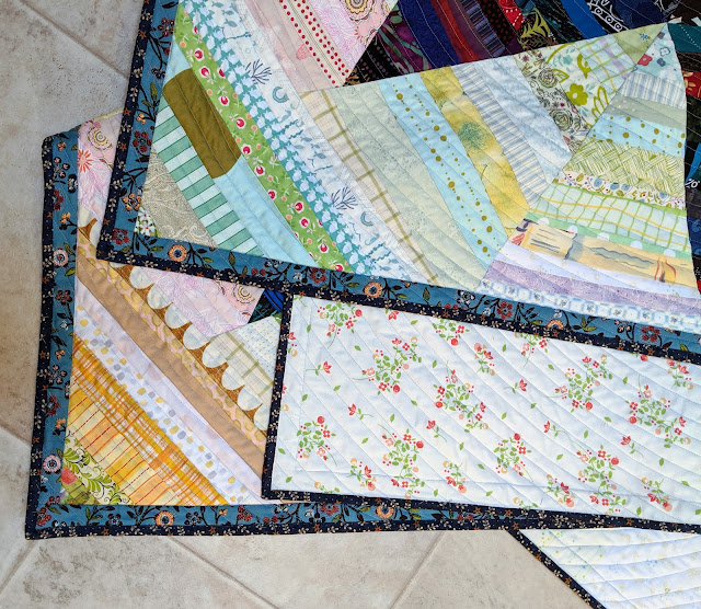 Folded quilt highlights front, back, binding, and quilting.