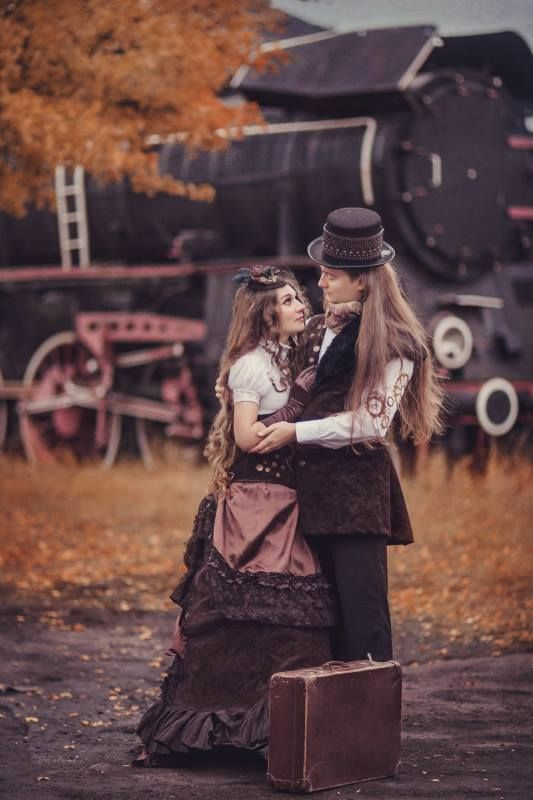 Steampunk couple in matching costumes (man and woman in shades of brown steampunk clothing)