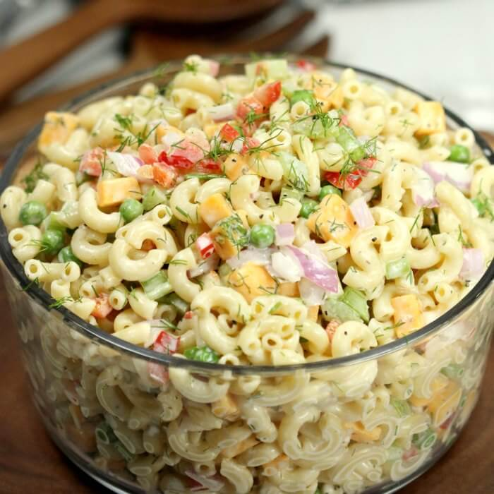 This Easy Macaroni Salad Recipe is my go to dish to bring to potlucks, BBQ's, parties and more. It is loaded with lots of delicious veggies, cheese and more!
