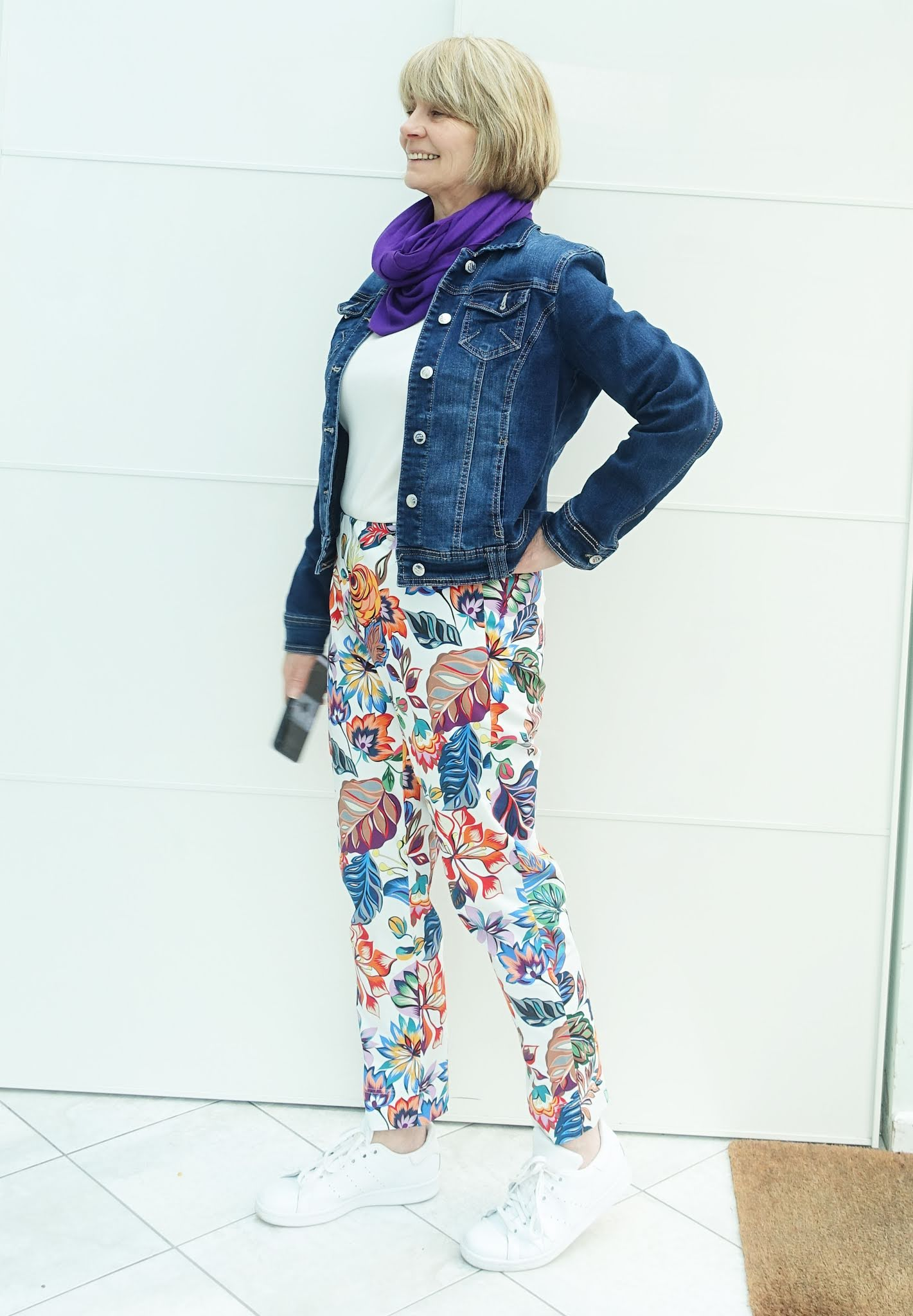 A casual look for colourful botanical patterned trousers from Kettlewell with a denim jacket and white trainers