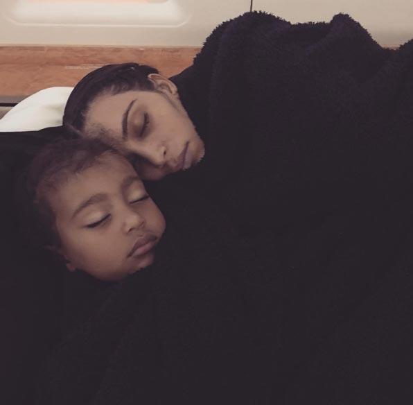 Aww! This photo of Kim Kardashian an North West sleeping is everything