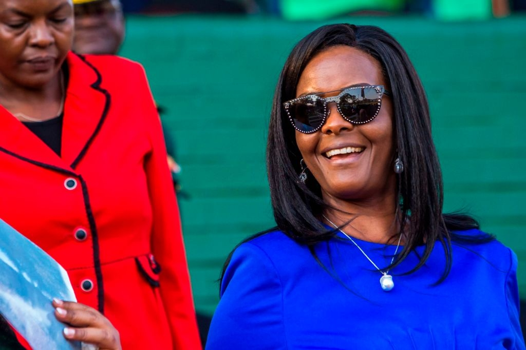 Zimbabwe first lady Grace Mugabe attends the opening of the annual agricultural fair on August 25, 2017 in the capital Harare. Zimbabwe's first lady Grace Mugabe appeared in public for the first time since she returned from South Africa where she was accused of assaulting a model and granted diplomatic immunity. The first lady, who is seen as possible successor to her 93-year-old husband, was granted diplomatic immunity by South Africa at the weekend and flew out of the country. / AFP PHOTO / Jekesai NJIKIZANA (Photo credit should read JEKESAI NJIKIZANA/AFP via Getty Images)