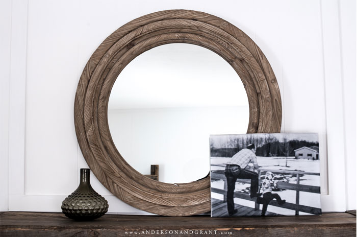 Mirror, vase, and canvas print on mantel