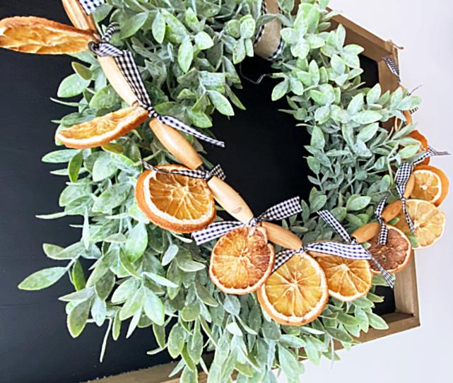 Beaded orange slice garland on a wreath
