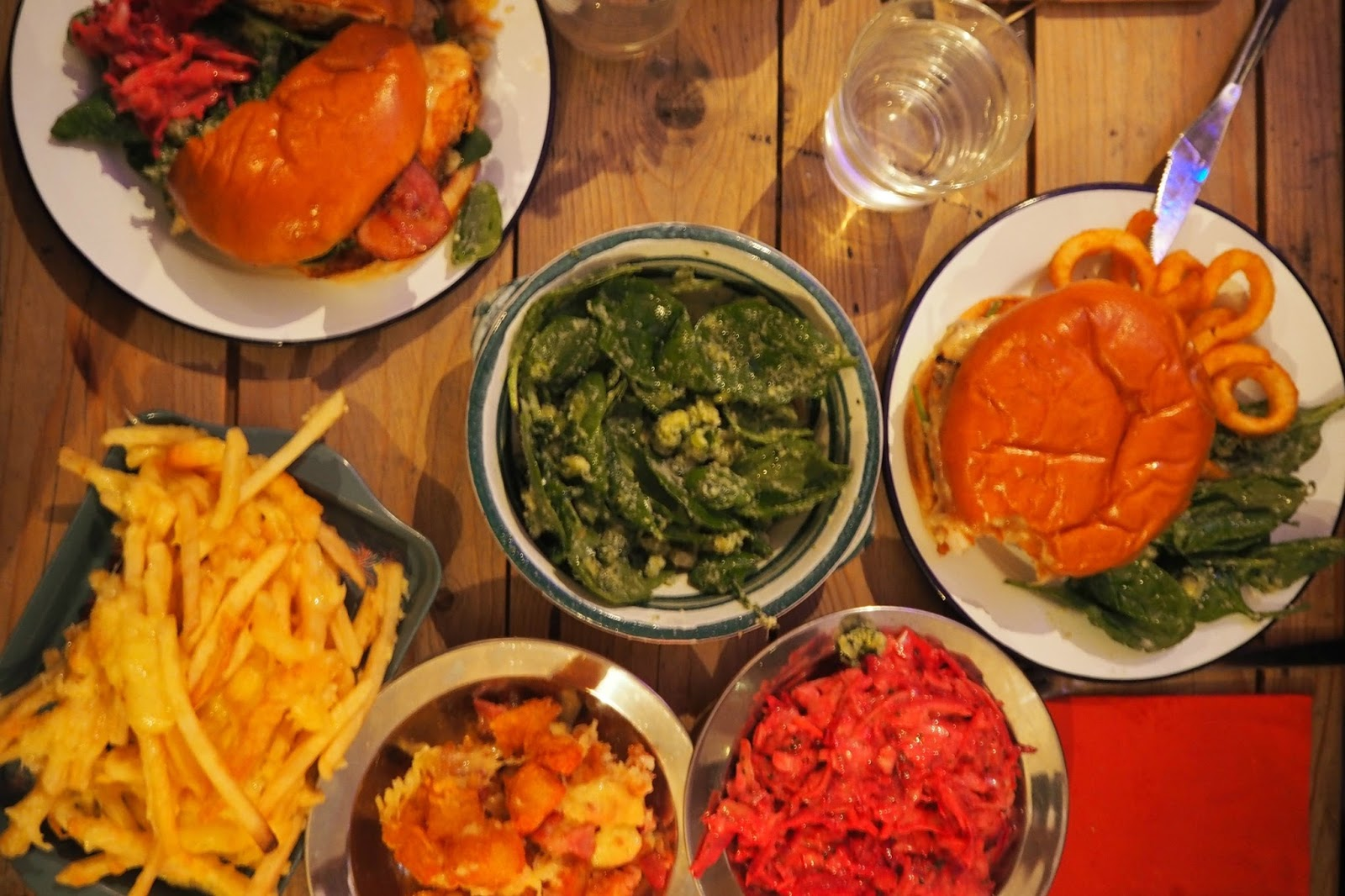 aerial view of burgers with side dishes