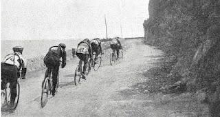 Action from one of the earliest Milan-Sanremo races as riders head along the Ligurian coast road