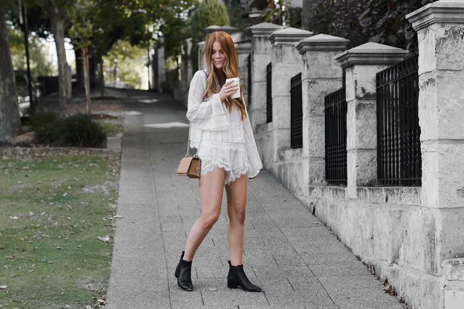 Elliatt top and shorts, Oroton Forte clutch, flared sleeves, Acne Jensen boots