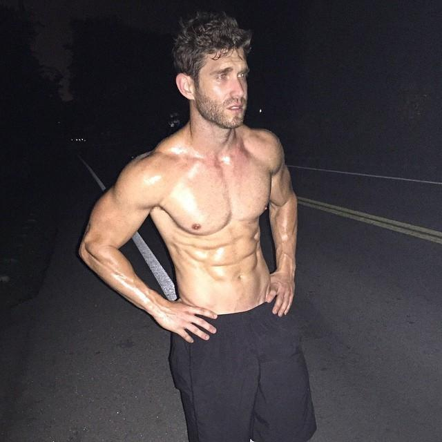 sweaty-shirtless-fit-bearded-dude-black-shorts-abs-hunk